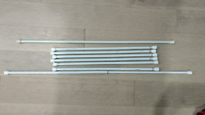 Tension rods for window curtains