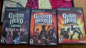PS2 - Rockband / Guitar Hero with Guitar & Dongle London Ontario image 3