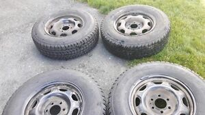 Set of Firestone Winter Force Tires with Black Wheel Sensor Rims
