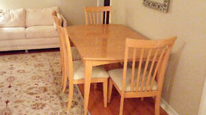 6 chair dining room table with extension leaf.