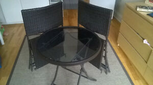 Folding set / glass top table and two chairs