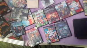 PS2 WITH MANY GAMES & 2 MEM CARDS