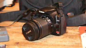 Canon Rebel EOSxti with accessories and book