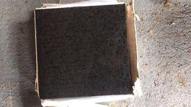 11 black granite tiles 305x305cm