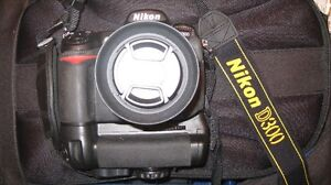 """Great NIKON D300,Comes with adapter to use SD Cards,Batt Grip!"