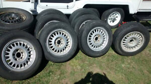 Nice set of four 1989 to 93 BMW rims with 215 65 15 tires