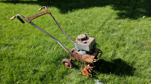Antique Briggs and Stratton Motor on a Vintage Rototiller