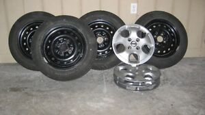 4 michelin premier tires, rims and wheel covers