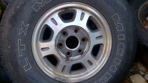 2002 gmc 1500 6bolt alum rims with good tires fits many others