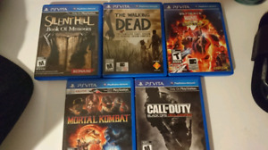 PlayStation vita w\ case and 5 games