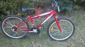 24in Supercycle SC1800, excellent condition, 18 sp, kick stand,