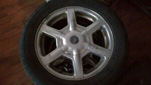 115x5 aluminum rims with great rubber all season