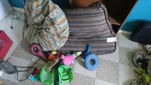 Free dog beds, toys and backpack