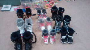 various ski boots and snowboard boots