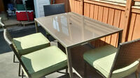 glass patio table plus 4 chairs & cushions