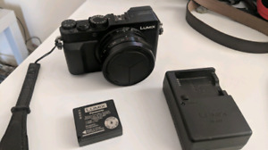 Panasonic lx100 camera with case and extra battery