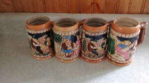 Set of four ceramic beer steins