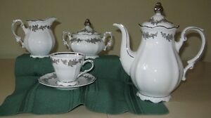 Coffee set with cups and saucers