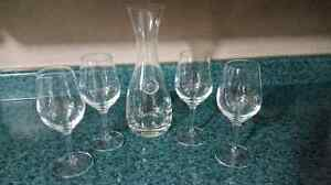 Set up 4 wine glasses with decanter