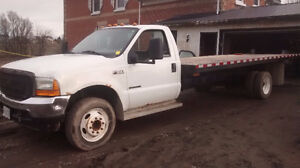 FORD F 550----21 FOOT FLATBED---LOW KMS