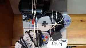 Super Nintendo Console with 2 controllers   519 439 7772