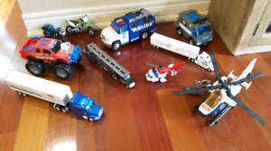 Toy cars and trucks and motorcycles