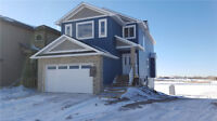 Brand New Home In Strathmore Lake Community