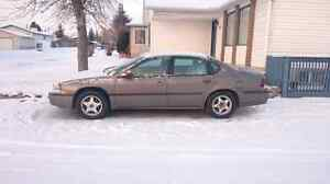 2003 Chevy Impala; Automatic, power everything.