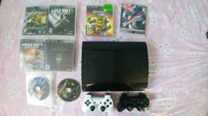 Playstation 3 with 8 games and 2 controllers for sale
