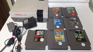 Nes with cords and 7 games