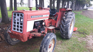 IH 454 tractor &7ft kioti  finishing.  Mower