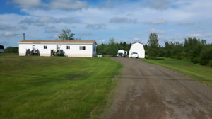 Mini home with 1.6 acres of land