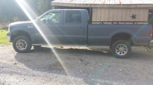 2007 F350 Diesel with western plow $ 6,500.00 or B.0