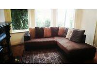 Brown leather and fabric corner sofa