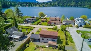 OPPORTUNITY KNOCKS LAKE VIEWS!  .32 ACRE access to waterfront