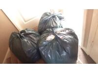 3 black bags full of baby girls clothes