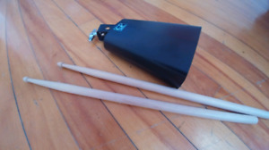 Cowbell and drumsticks