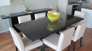 Granite dining table with 8 chairs and buffet