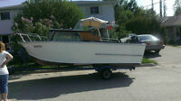 Chris Craft Cavalier wood boat with 30 horsepower Evinrude.