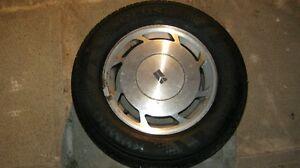 215/65R15 Kumho all-season tires/ Olds 88 alloy rims