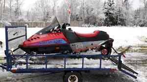 Bombardier snow mobile and trailer