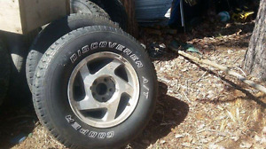 Rims & tires off a ford