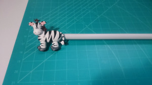 Zebra curtain rod
