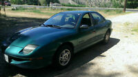 1998 Pontiac Sunfire Sedan, 2 cars.