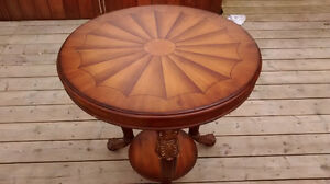 small round table , imitaion wood , carved legs, 3 legs