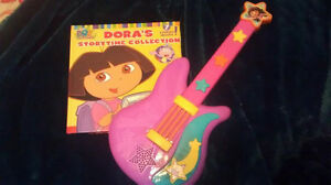 Dora guitar and Dora Storytime collection with 7 stories.