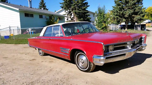 1966 Chrysler 300. 383 4bbl. console 4 door ht