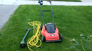 Electric lawnmower, electric weed wacker and extension cord