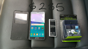 $285Firm UNLOCKED Samsung NOTE4 in very good condition+flip view