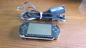 Original Sony PSP 1000 w/ charger, games available